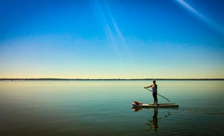 Stay cool during a Perth summer by choosing water-based activities such as paddle boarding.